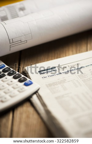 newspaper business page and calculator - stock photo