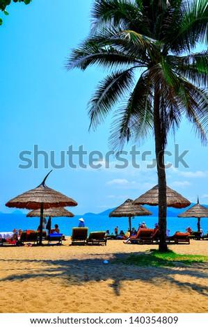 Nha Trang beach, Vietnam. Nha Trang is a coastal city in Vietnam, famous with beautiful beaches and bays - stock photo