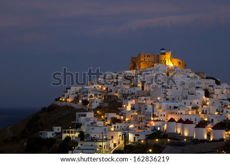 Night view of Chora with the historic Querini Castle at the top - Astypalea Island, Greece - stock photo