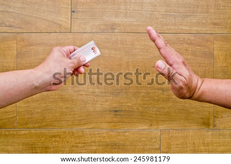no corruption (hand giving banknote while another hand refuse)  - stock photo