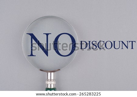 """""""No Discount"""" text concept with magnifying glass - stock photo"""