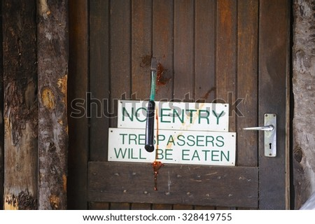 No Entry sign on an old wooden door