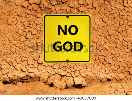 """No God"" sign on parched earth - stock photo"