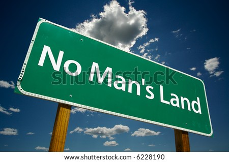 """No Man's Land"" Road Sign with dramatic blue sky and clouds."