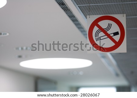 'No-Smoking' sign hung on a ceiling of a public place. - stock photo