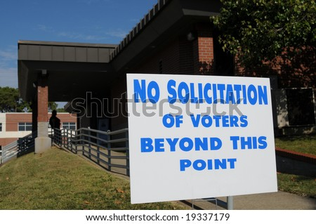 """No solicitation of voters"" sign posted outside a polling place - stock photo"