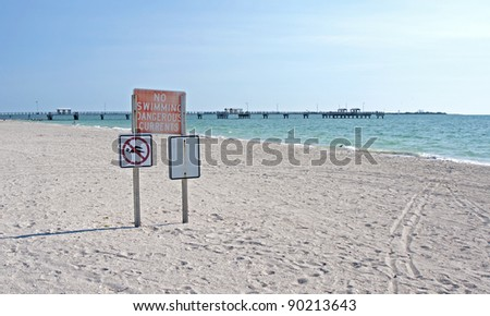 """""""No Swimming Dangerous Currents"""" sign at the beach, Florida. - stock photo"""