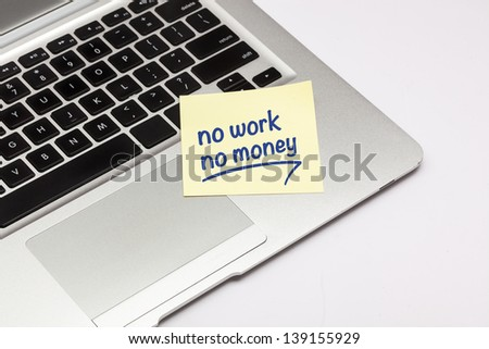 """no work no money"" written on sticky note, on laptop keyboard. - stock photo"