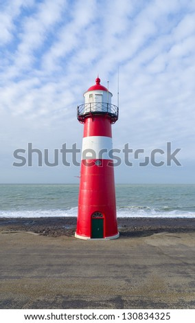 """Noorderhoofd""  lighthouse in Westkapelle, Netherlands. It has 3 colors of light, white (6000 candela), red and green (1800 cd). Together with another lighthouse it sends its  beacon to the ""Oostgat"" - stock photo"