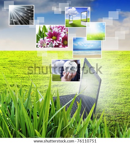 notebook against green nature background