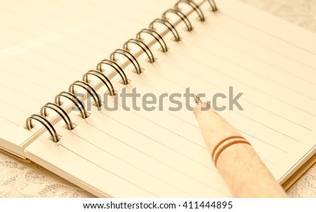Notebook& pencil on the table back ground. - stock photo