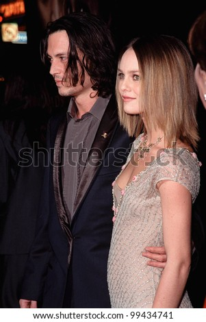"""17NOV99:  Actor JOHNNY DEPP & girlfriend French actress/singer VANESSA PARADIS at the world premiere, in Hollywood, of his new movie """"Sleepy Hollow.""""  Paul Smith / Featureflash - stock photo"""