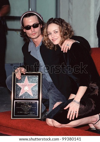 16NOV99: Actor JOHNNY DEPP & girlfriend French actress/singer VANESSA PARADIS in Hollywood where he was honored with the 2,149th star on the Hollywood Walk of Fame.  Paul Smith / Featureflash - stock photo