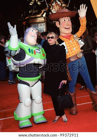 """13NOV99:  Actress KIRSTIE ALLEY with characters BUZZ LIGHTYEAR (left) & WOODY at the world premiere of Disney/Pixar's """"Toy Story 2"""" at the El Capitan Theatre, Hollywood.  Paul Smith / Featureflash - stock photo"""