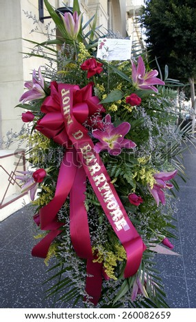 30 November 2004 - Hollywood, California - Flowers at the Hollywood's Walk of Fame star of the respected film actor John Drew Barrymore.  - stock photo