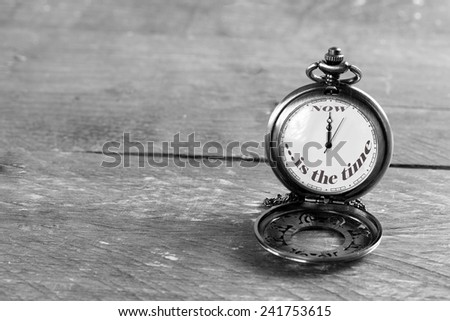 ''now is the time'' written on pocket watch  - stock photo