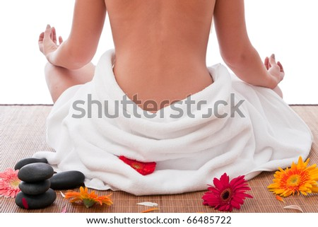 Nude women sitting in spa and meditating - stock photo