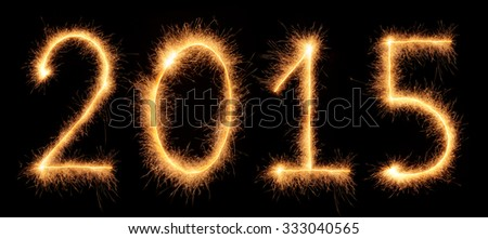 """2015"" number drawn with bengali sparkles isolated on black background - stock photo"