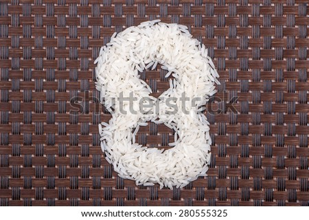 8, number from raw rice - stock photo