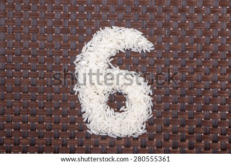 6, number from raw rice - stock photo