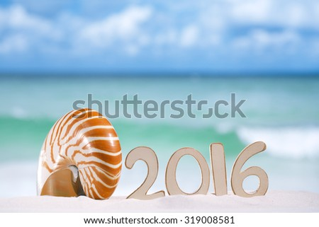 2016 numbers letters with seashell, ocean , beach and seascape, shallow dof - stock photo