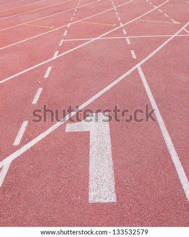 """""""1"""" Numbers on red running track - stock photo"""