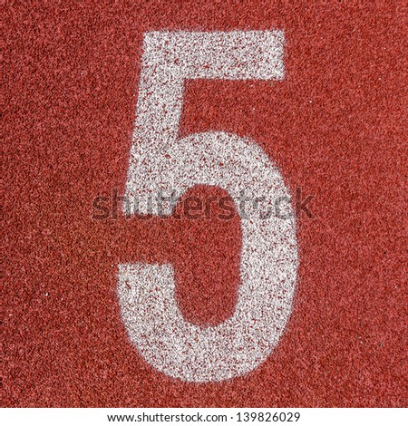 """""""5"""" Numbers on red running track - stock photo"""