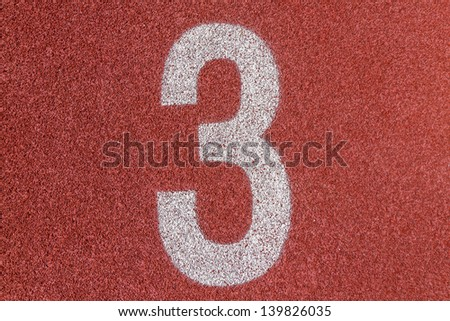 """""""3"""" Numbers on red running track - stock photo"""