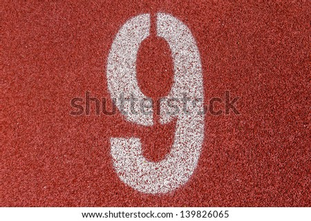 """""""9"""" Numbers on red running track - stock photo"""