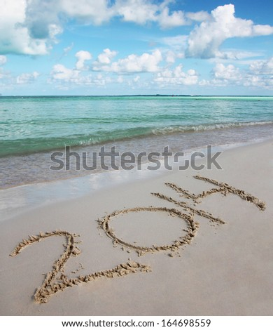 2014 Numbers on Tropical Sand Beach. Holiday concept. New Year