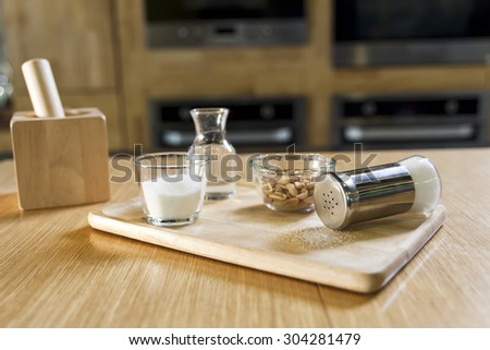 nuts, salt shaker ans sugar on kitchen counter