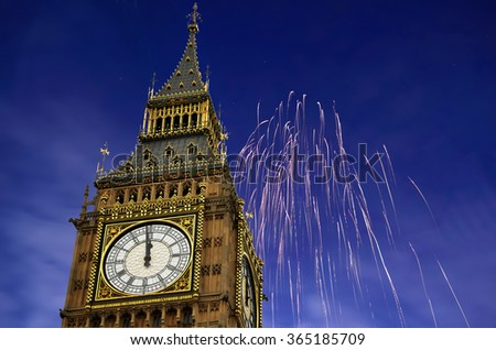 12 O'Clock in Big Ben, Fireworks are displayed on sky to celebrate new year. - stock photo