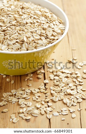 oatmeal on wooden table - stock photo