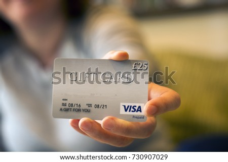 Visa gift card stock images royalty free images vectors 9 october 2017 royston uk woman holding a 25 gift card illustrative negle Gallery