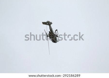 ODESSA, UKRAINE - June 4, 2013: Presentation of the private test light modern civil helicopter business class on a small private airport in the summer on a cloudy day