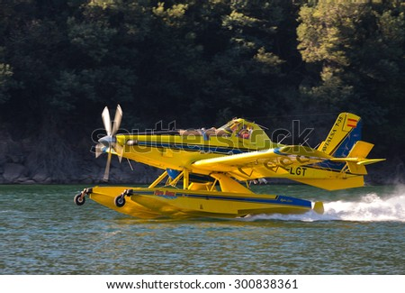 23 of July 2015, Avialsa T-35 - EC-LGT Fire-Fighter Airplane taking water in Geres National Park Dam, Portugal - stock photo