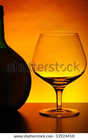 ?ognac bottle and glass - stock photo