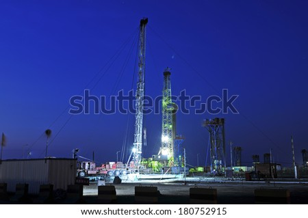 Oil drilling in the evening