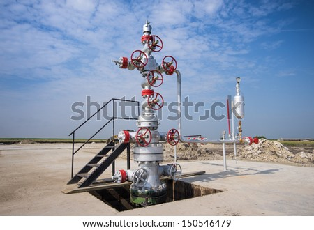 Oil drilling platform in the plain - stock photo
