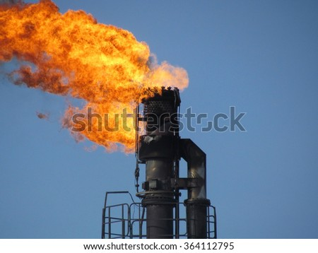 Oil industry. Flaming gas torch - stock photo