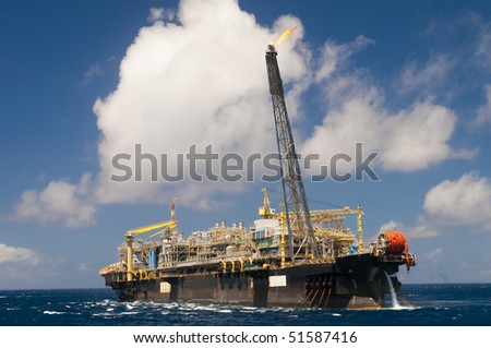 oil rig in offshore area (coast of brazil ) - stock photo