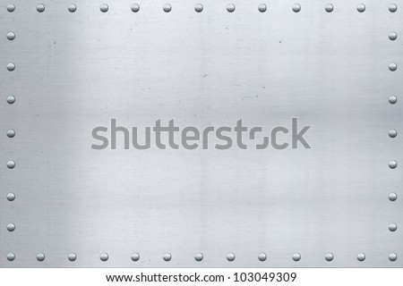 Old aluminum sheet, showing scars and scratches, with riveted edges./ Vintage Aluminum, Riveted Edges / Great background for text, painting, or whatever your notion. - stock photo