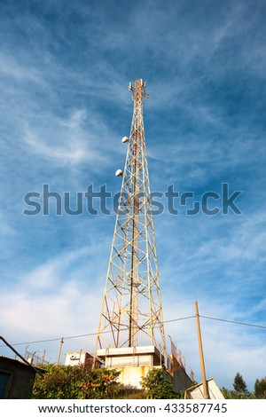 old Antennas of cellular systems with blue sky   - stock photo
