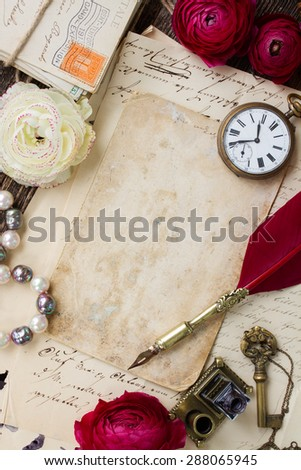 old blank page on pile of  old letters with feather pen - stock photo