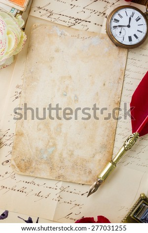 old blank paper on pile of  old letters with feather pen - stock photo