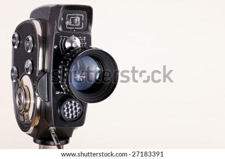 old cinema camera on white background - stock photo