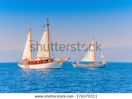 2 Old classic wooden sailing boats  during a Classic Boats Regatta in Spetses island in Greece - stock photo