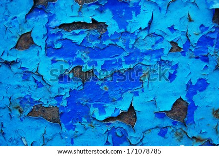 Old cracked paint pattern on rusty background. Peeling paint. Pattern of rustic blue grunge material. Damaged paint on the metal surface. Scratched old metal plate - stock photo