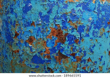Old cracked paint pattern on rusty background. Peeling paint. Pattern of rustic blue grunge material. Damaged paint on the metal surface.  - stock photo