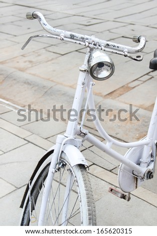 old-fashioned bicycle - stock photo